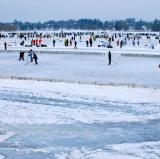 Playing hockey outside on a lake in Minneapolis<br />photo credit: minnpost.com