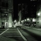 Streets of any big city. At night. Empty.